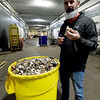 J-M Farms Vice President of Operations Scott Englebrecht stands near a barrel of broken mushroom stems and mushrooms that may have inadvertently been dropped on the floor on Friday at the Miami company's site. The discarded mushrooms are repurposed to be sold to local cattle operations.<br /> Globe | Laurie Sisk