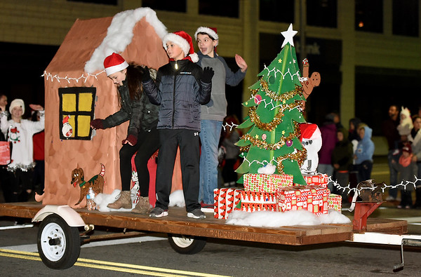 Members of the East Middle School Student Council wave from their float during the 49th Annual Joplin Christmas Parade on Tuesday night in downtown Joplin. Globe | Laurie Sisk