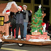 Members of the East Middle School Student Council wave from their float during the 49th Annual Joplin Christmas Parade on Tuesday night in downtown Joplin.<br /> Globe | Laurie Sisk