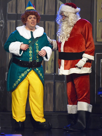 """Buddy the Elf (Jeff Phillips) shares the fear he may be human with Santa (Caleb Hilsenbeck) during the final dress rehearsal for the Ozark Christian College production of """"Elf: The Musical"""" on Wednesday night at OCC.<br /> Globe 