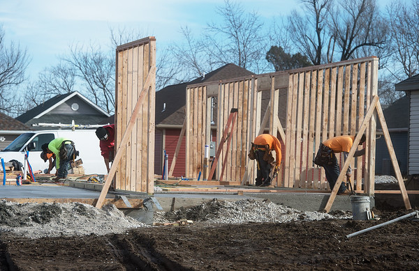 Construction continues on a housing development near 18th and Pennsylvania on Wednesday in Joplin.<br /> Globe | Roger Nomer