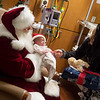 Ellen Shaner, 2 weeks old, and her mother Tristan, Joplin, meet Santa at the Freeman Neonatal Intensive Care Unit on Friday at Freeman Hospital. Children's Miracle Network helped sponsor the visit and delivered gifts of blankets and stuffed animals.<br /> Globe | Roger Nomer