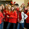 About 150 members of the Webb City Choir Club, under the direction of Beth Buford, entertain local seniors during a special Christmas Concert on Thursday at the Joplin Senior Center.<br /> Globe | Laurie Sisk