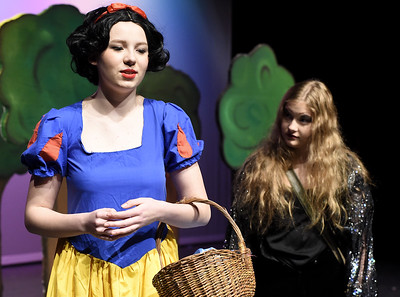 "From the left: Elise Leek (as Snow White) and Jasmine DeGroat (as a witch) rehearse their roles for the upcoming Joplin High School production of ""Snow White and the Missing Dwarfs"" on Tuesday at JHS. Globe 