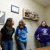 (from left) Addison Campbell, Abygail Clapp, Dacey Brown, Margaret Tanner and Keran Bentley, seventh graders at Wyandotte Middle School, talk about their upcycled sculpture on Tuesday at the school.<br /> Globe | Roger Nomer
