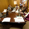 From the left: Hugh Shields, SWMO Democrats Executive Director Krista Stark, Dena Waite, Elliott Denniston and Penny Hagedorn watch the impeachment proceedings on Wednesday at the SWMO Democrats headquarters.<br /> Globe | Laurie Sisk