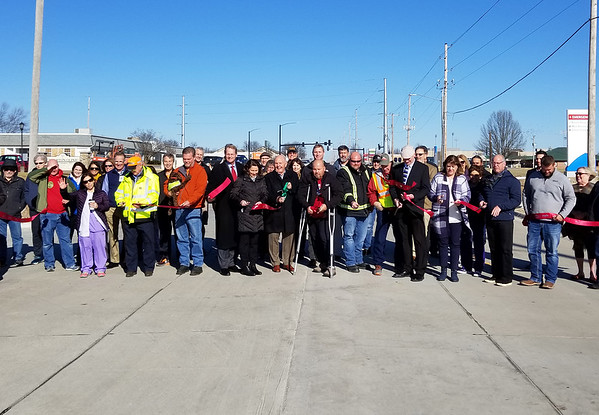 Pittsburg city leaders, area businesses, Kansas Department of Transportation crews and community members cut the ribbon during a ceremony Wednesday to mark the completion of the $4.1 million South Rouse Street Widening & Trail Project.  Kimberly Barker/JoplinGlobe