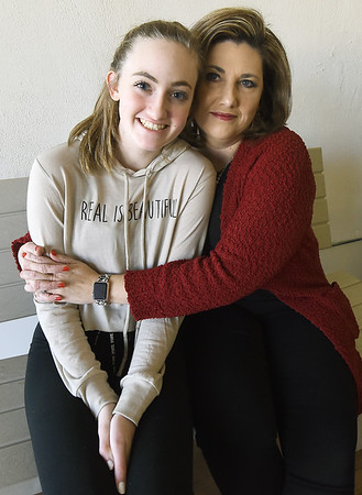 Lisa Brodrick sits with her daughter, Alexis Brodrick, before dance practice on Saturday at Dance Academy in Miami. Alexis is about the same age that Lisa's cousin, Lauria Bible was when she disappeared 20 years ago,<br /> Globe   Laurie SIsk