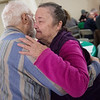 Linda True hugs her father David Dailey during the annual Christmas meal at the First Community Church in Joplin on Wednesday.<br /> Globe | Roger Nomer