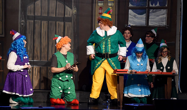 """Jeff Phillips, center, portrays Buddy the Elf during the final dress rehearsal for the Ozark Christian College production of """"Elf: The Musical"""" on Wednesday night at OCC.<br /> Globe 