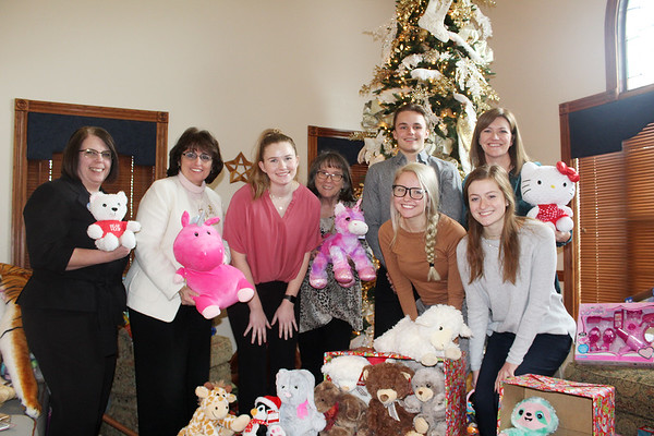 Carl Junction High School students and members of the school's National Business Honor Society — Taylor Hughes, Lance Ward, Brooke Buchele and Lakyn Shallenburger — spent the last three weeks gathering up four large boxes of stuffed animals, donated from 40 or so CJHS students, that were collected in pink boxes and dropped off Friday afternoon at the Ronald McDonald House Of The Four States, 3402 S. Jackson Ave. in Joplin. Officials with RMH that received the donated animals included: Jerri Sargent, program manager, Annette Thurston, executive director, Shirley Hylton, program coordinator and Christina Hardy, assistant director. The stuffed animals are given to mothers staying at the house while their newborn is in the hospital. At the time of their release, the mother gets to keep their chosen stuffed animals a keepsake. <br /> Globe | Kevin McClintock