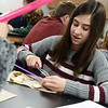 Kennah Scheurich, seventh grader at Thomas Jefferson, works on a lab about osmosis on Monday at Thomas Jefferson Independent Day School.<br /> Globe | Roger Nomer