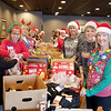 Volunteers fill 500 Christmas bags for distribution by the Salvation Army on Thursday at the Joplin Elks Club. The womens group started in 2007 by Sharon Boyd, and has grown in size every year. Gifts are donated from the community, and the bags are given out during the Salvation Army's Christmas program, as well as delivered on Christmas Day.<br /> Contributed Photo