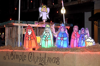 A colorful nativity scene completes the One Church float during the 49th Annual Joplin Christmas Parade on Tuesday night in downtown Joplin. Globe | Laurie Sisk