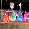 A colorful nativity scene completes the One Church float during the 49th Annual Joplin Christmas Parade on Tuesday night in downtown Joplin.<br /> Globe | Laurie Sisk