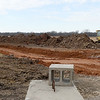 Workers begin digging the base for a road that will lead to J-M Farms new state-of-the art pasteurization and final compost conditioning operation as the Miami company celebrates its 40th anniversary.<br /> Globe | Laurie Sisk