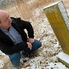 Clyde Hood, a member of the Jasper County Cemetery Preservation Committee, looks at a headstone at the Jasper County Cemetery on Tuesday.<br /> Globe | Roger Nomer