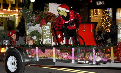 A menacing Grinch rides on the Camp Mintahama float during the 49th Annual Joplin Christmas Parade on Tuesday night in downtown Joplin. Globe | Laurie Sisk