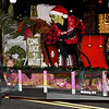 A menacing Grinch rides on the Camp Mintahama float during the 49th Annual Joplin Christmas Parade on Tuesday night in downtown Joplin.<br /> Globe | Laurie Sisk