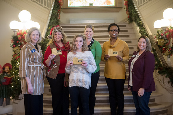 (from left) Rebecca Dunham, sales manager with Arvest Bank, Linda Teeter, owner of Urban Arts Gallery, Jaclyn Baker, manager of Infuxn Kitchen and Cocktails, Lori Haun, executive director of Downtown Joplin Alliance, Jacqueline Hackett, co-owner of Hackett's Hot Wings, and Lacie Wagner, marketing manager with Arvest Bank, attend the awards ceremony for the Downtown Window Decorating Competition at Joplin City Hall on Thursday. Urban Art Gallery won the most humerous award, Hackett's won the most festive award and Infuxn won the most lights award. The competition was presented by the Downtown Joplin Alliance and sponsored by Arvest Bank.<br /> Globe   Roger Nomer