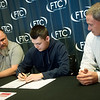 (from left) Steve Ratliff, Missouri admission representative for the University of Northwestern Ohio, Jackson Carter, senior, and Marc Smallwood, HVAC instructor at Franklin Technology Center, attend Carter's signing for his scholarship award on Thursday at Franklin Tech.<br /> Globe | Roger Nomer