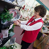 On Thursday, Lana Mathis works with clearance sale items as Carthage Hardware prepares to close its doors.