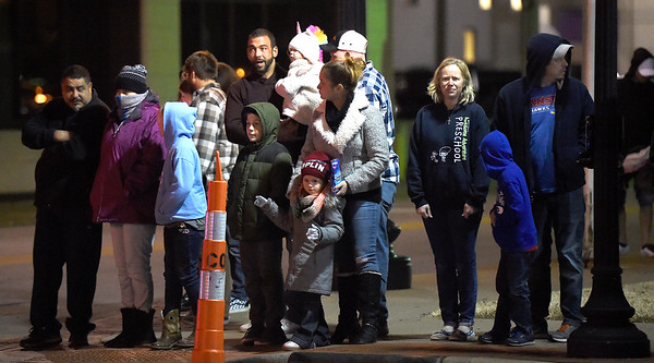Spectators await the start of the 49th Annual Joplin Christmas Parade on Tuesday night in downtown Joplin.<br /> Globe | Laurie Sisk