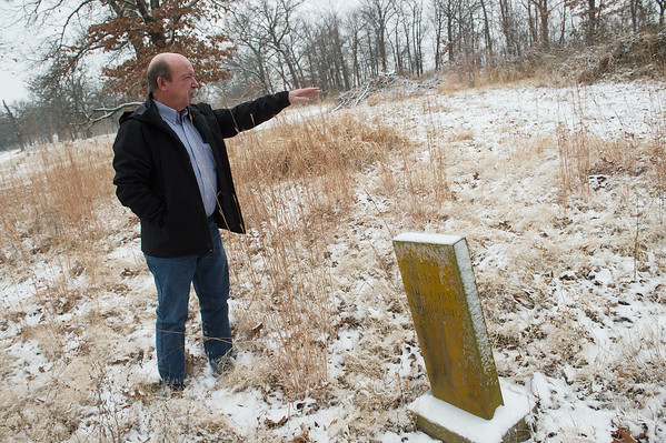 Clyde Hood, a member of the Jasper County Cemetery Preservation Committee, talks about the Jasper County Cemetery on Tuesday in Carthage.<br /> Globe | Roger Nomer