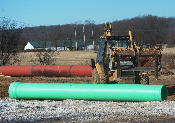 Workers with Asbell Construction work on a new sewer line along Apricot Drive in Joplin on Thursday.<br /> Globe   Roger Nomer