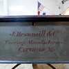 The manufacturer of the centennial wheelbarrow is painted on the back of the centennial wheelbarrow.<br /> Globe | Laurie Sisk