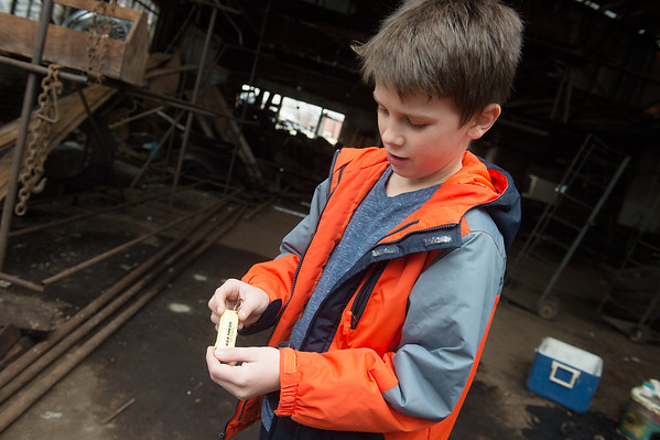 Ephraim Patrick shows a combination keychain flashlight he found inside the former De Soto car plant in Carthage on Friday.<br /> Globe | Roger Nomer