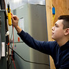 Jackson Carter, senior, works on a HVAC project at Franklin Tech on Thursday.<br /> Globe | Roger Nomer