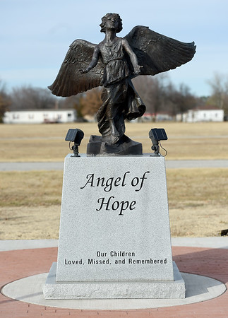 The Angel of Hope statue stands in the Garden of Angels at Miami's G.A.R. Cemetery on Wednesday. The 2nd Annual Angel of Hope Candlelight Remembrance Ceremony will be Friday at 7 p.m. at the cemetery.<br /> Globe | Laurie Sisk