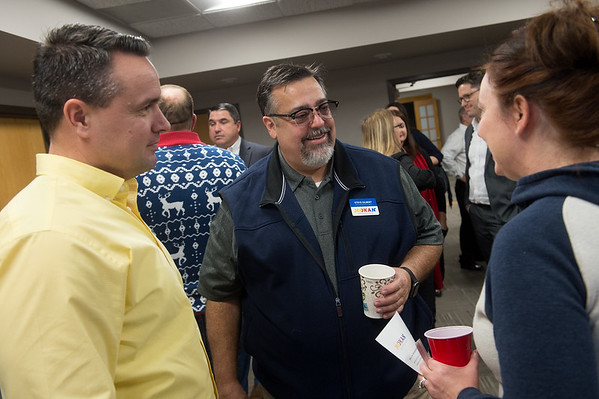 Steven Gilbert (center), Oklahoma/Kansas Region Business Development with the MOKAN Partnership, talks with Chett Daniel, director of institutional research innovations at Crowder College, and Melissa Smith, director of the Joplin Advanced Training and Technology Center for Crowder College, on Friday at the Joplin Area Chamber of Commerce.<br /> Globe | Roger Nomer