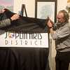 (from left) Doug Hunt, Jerry Carpenter and Linda Teeter unveil a new logo for the Joplin Arts District on Wednesday at the Spiva Center for the Arts.<br /> Globe | Roger Nomer
