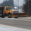 A Missouri Department of Transportation truck salts south Main Street in Joplin on Monday.<br /> Globe | Roger Nomer
