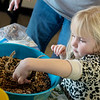 Aubrey Bradley, 5, Joplin, makes a pinecone birdfeeder during Wednesday's The After Christmas Tree program at the Shoal Creek Conservation and Education Center. The program was put on by the Wildcat Glades Friends Group.<br /> Globe | Roger Nomer