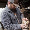 Caleb Patrick looks over order forms found inside the former De Soto car plant in Carthage on Friday.<br /> Globe | Roger Nomer