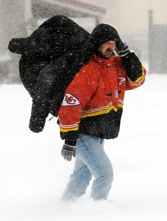 Globe/T. Rob Brown<br /> Bill Allen, of Carl Junction, walks against the wind on South Range Line Road in Joplin as he braves the elements during the blizzard Tuesday, Feb. 1, 2011.