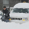 Globe/T. Rob Brown<br /> Tim Coffey, of Webb City, clears a path so he can drive his Jeep out of a South Range Line Road parking lot during the blizzard Tuesday, Feb. 1, 2011, in Joplin.