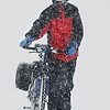 Globe/T. Rob Brown<br /> Cindy Wing, who lives north of Joplin, walks alongside her bicycle down Range Line Road, near 15th Street, during the blizzard Tuesday, Feb. 1, 2011, in Joplin. Wing said she walked the bicycle 7 miles in the snow to get to work at IHOP on South Range Line Road. Due to the high rate of snow and haze, none of the Range Line businesses are even visible.