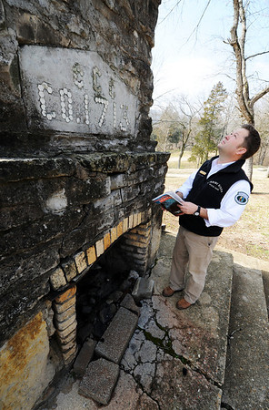 Globe/T. Rob Brown<br /> Dusty Reid, Roaring River State Park superintendent, looks up at a tall fireplace built by CCC workers during a tour Thursday, Feb. 16, 2012, at the historic park near Cassville.