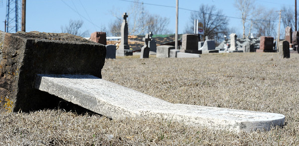 Globe/T. Rob Brown<br /> Gravestones show the damage they received from Tuesday night's severe storm, at Highland Park Cemetery, Pittsburg, Kan., Wednesday afternoon, Feb. 29, 2012.