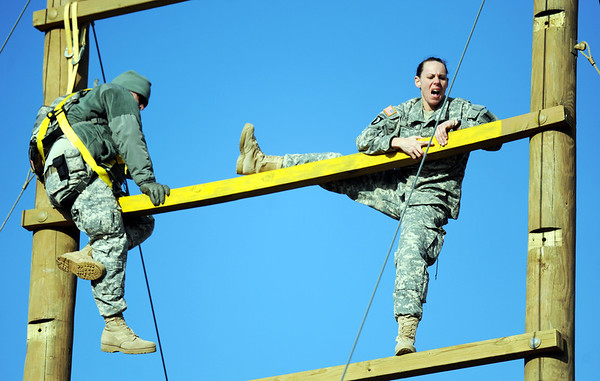 Globe/T. Rob Brown<br /> 1st Lt. Heather Adams, of St. Louis, reaches the highest point of one of the two most-difficult obstacles Tuesday morning, Feb. 28, 2012, on an Army National Guard obstacle course at Camp Crowder in Neosho. About 200 soldiers started their air assault training.