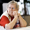 Globe/T. Rob Brown<br /> Election Judge Lucille Myers, of Carl Junction, stares out the from windows of First Christian Church of Carl Junction as she waits on voters to show up Tuesday morning, Feb. 7, 2012. The election judges for Precincts 1 and 2 in Carl Junction said they were having low turnout.