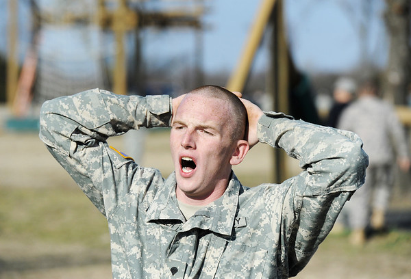 "Globe/T. Rob Brown<br /> Spc. Nicholas Wheeler, of Kansas City, Mo., yells out ""Air Assault"" as he maneuvers through an obstacle course Tuesday morning, Feb. 28, 2012, with the Army National Guard at Camp Crowder in Neosho. About 200 soldiers started their air assault training."