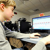 Globe/T. Rob Brown<br /> Seventh grader William Novalany uses advanced robot-programming software Wednesday after school, Feb. 8, 2012, at Seneca Intermediate School.