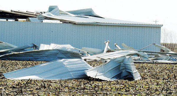 Globe/T. Rob Brown<br /> A metal farm building shows the results of Tuesday night's severe storm, less than a mile west of Lamar on Missouri Highway 160 Wednesday afternoon, Feb. 29, 2012.