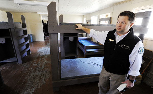 Globe/T. Rob Brown<br /> Dusty Reid, Roaring River State Park superintendent, looks around in Cabin 1 built by CCC workers during a tour Thursday, Feb. 16, 2012, at the historic park near Cassville.