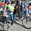 Globe/T. Rob Brown<br /> Irving Elementary School at Washington third graders, from left, Mike Huddleston, Nathan Arivett and Alexia Neal, all in Shelly Tarter's class, look over their new bicycles donated by Payless Shoesource Tuesday morning, Feb. 14, 2012. The company donated more than 200 bikes, custom-built by a large group of Payless Shoesource employees in less than two hours, to every student in the school